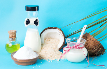Various coconut products against blue background