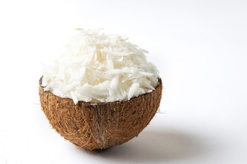 Grated coconut in a natural shell