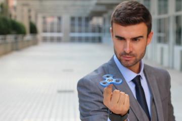 Hypnotic fidget spinner distracting a businessman
