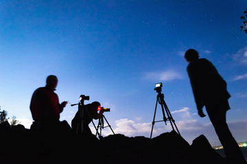 Three photographers shooting night landscapes