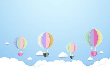 colorful hot air balloons flying the sky background. Paper art and craft style design