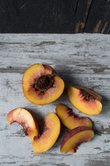 sliced peach in rustic setting top view