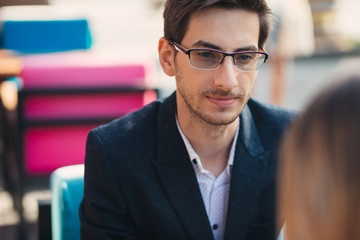 Young entrepreneur in glasses discussing
