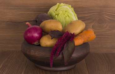 Fresh organic vegetables  on wooden background. Healthy food
