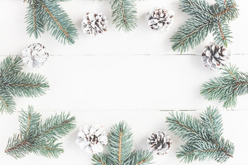 Christmas composition. Frame made of fir branches on white wooden background. Christmas, winter concept. Flat lay, top view, copy space