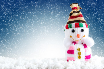 Merry christmas and happy new year background. Snowman standing in winter background.
