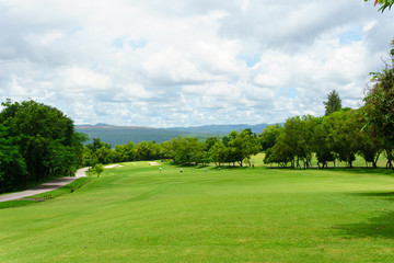 golf course with mountain and blue sky and cloud background