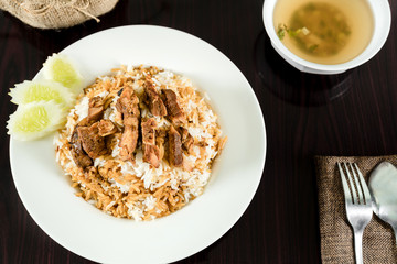 Rice, pork and chicken with fish sauce soup on the dining table.