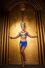 sexual beautiful egypt woman on the huge golden gates background