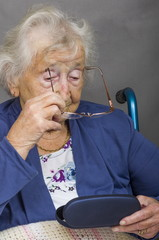 Senior Citizen putting Glasses on.