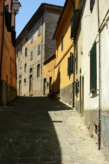 The city of Pistoia in Tuscany, Italy.  Narrow alley in the old town