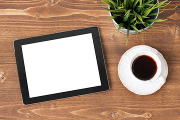 Tablet computer and coffie on wooden background