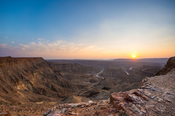 Deurstickers Canyon Fish River Canyon, scenic travel destination in Southern Namibia. Last sunlight on the mountain ridges. Wide angle view from above.