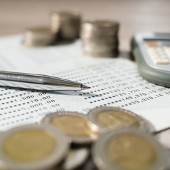 Saving Account Book from Bank for Business Finance with pen , calculator and coin