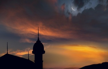 Beautiful sky  . Ramadan background  . Mosque at sunset . Moon and sunlight .    Sunset and new moon . Abstract religious  background with mosque