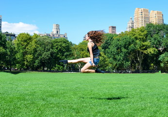 Girl jumping in Central park, New York