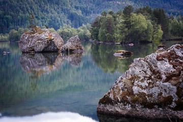 Stones in the lake with reflection in Norway