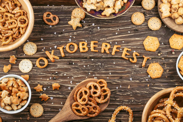 Word Oktoberfest made of salty crackers letters. Salty snacks. Pretzels, crackers
