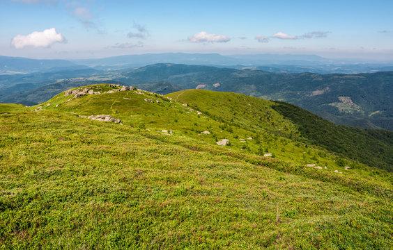 grassy hillside with huge boulders
