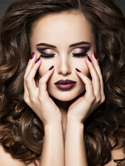 Fotobehang Beauty Beautiful face of woman with maroon makeup and nails