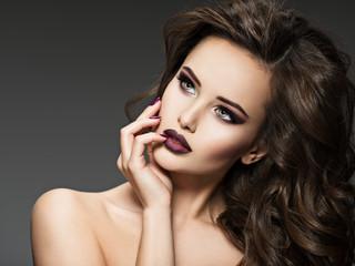 Portrait of an amazing girl with marron lips.