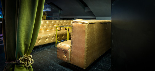 Golden sofas at luxury lounge bar interior