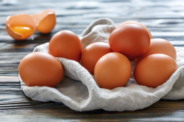 Brown chicken eggs on a linen towel.