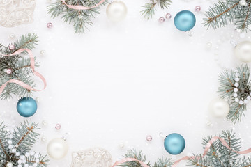 Stylish Frame with New Year decor and fir, frosty blue and pearly balls. Snowy texture.