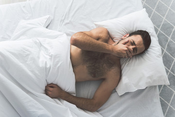 Exhausted male person wants to have a nap