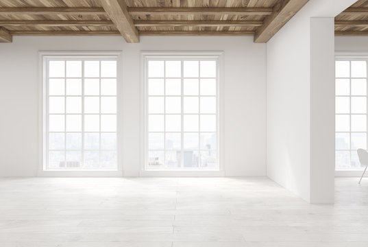 Empty room with large windows