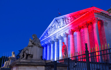 The French National Assembly lit up with colors of French national flag ,Paris.