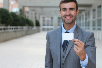 Professional showing his business card with copy space