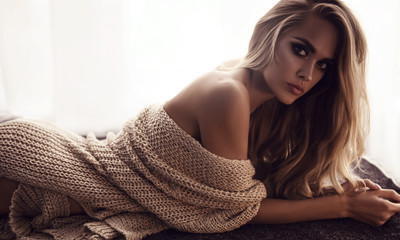 Charming attractive model in beige woollen sweater chilling in the morning