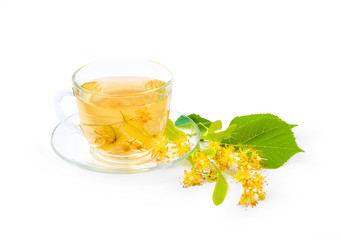 Tea from Linden flowers in glass cup with flower clusters of lim