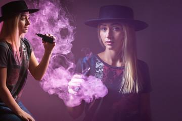 Vape girl. The girl smokes an electronic cigarette. ( vaping ) e-cigarette.