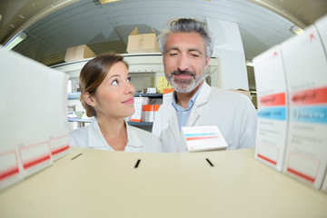 female and male pharmacists in the drug store