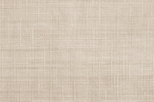 Jute hessian sackcloth canvas woven texture pattern background in light beige cream brown color