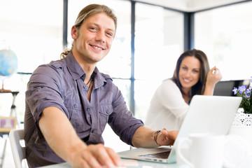 Handsome businessman working at computer