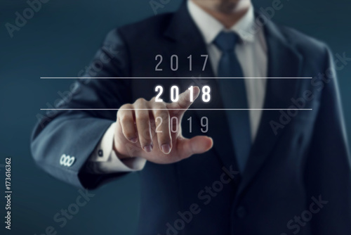 businessman pointing year 2018 business new year card concept