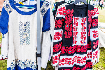 Display of embroidered Ukrainian slavic women traditional shirts embroidery clothing in outdoor flea market
