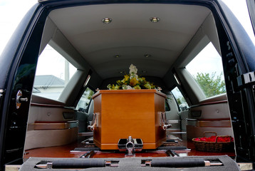 closeup shot of a colorful casket in a hearse or chapel before funeral or burial at cemetery Wall mural