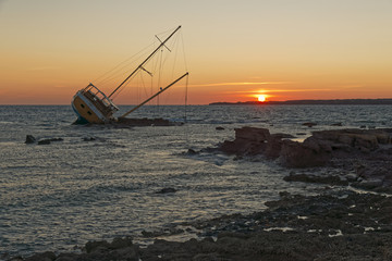 Sailing ship stranded on the rocks