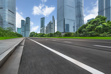 Fotomurales - urban traffic road with cityscape in background in Shanghai,China..