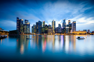 Beautiful illuminated Singapore central business district skyline at dusk under blue hour night sky, Singapore, Asia. Long time exposure