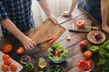 Couple cooking together delicious and healthy dinner