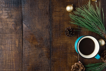 Christmas background, decorations and coffee on wooden table with border