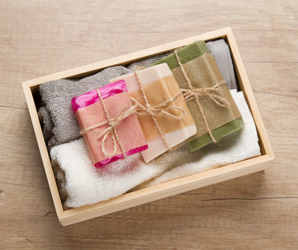 Handmade soap and towels in wooden box