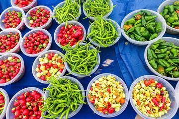 Fresh vegetables on the bazaar, celery, red radish, pepper