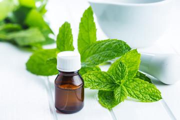 Bottle of essential mint oil.
