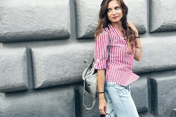 Fashion model walking on the city street Wall mural